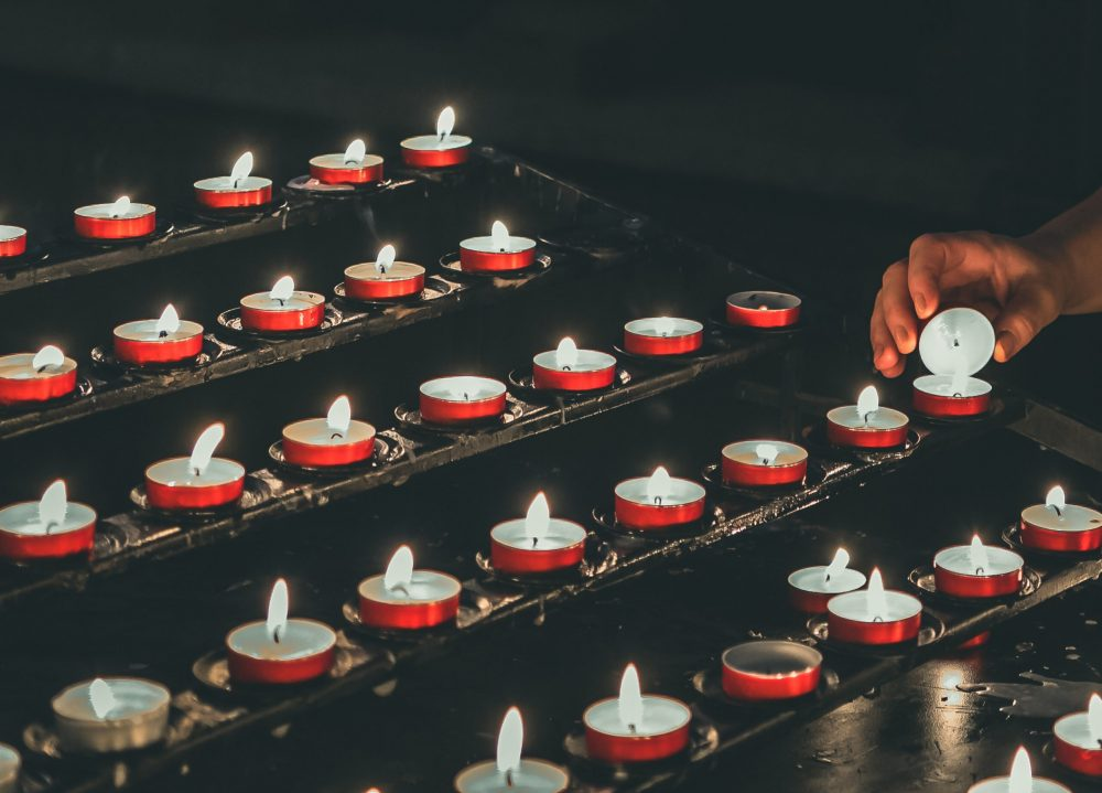 person-lighting-candle-3402746